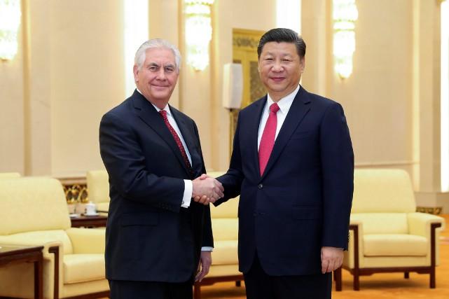 Le président chinois Xi Jinping (à droite) a... (Photo Lintao Zhang, REUTERS)