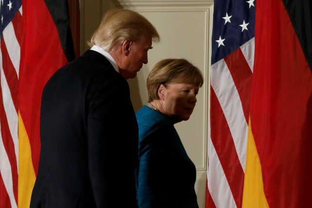 Donald Trump et Angela Merkel... (Photo REUTERS)