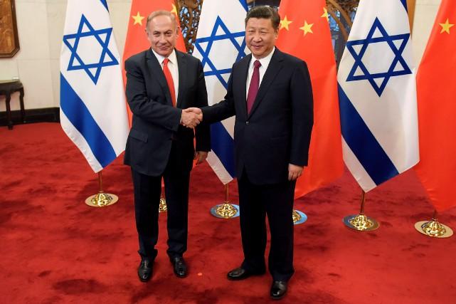 Benyamin Nétanyahou etXi Jinping.... (Photo Etienne Oliveau, Reuters)