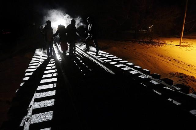 Sur cette photo de fin février, huit migrants... (John Woods, archives PC)