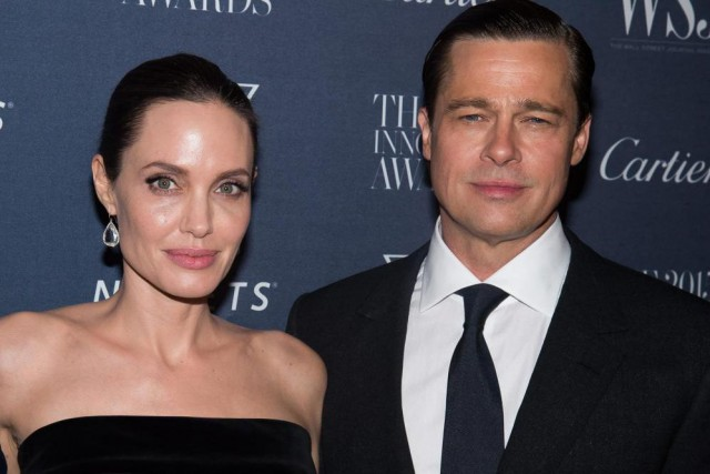 Angelina Jolie et Brad Pitt sont en processus... (PHOTO CHARLES SYKES, ARCHIVES INVISION/ASSOCIATED PRESS)