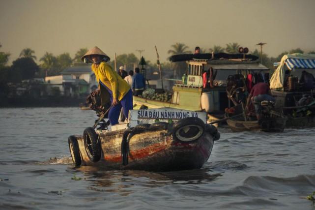 Le marché flottant de Cai Rang est une... (PHOTO IOURI PHILIPPE PAILLÉ, COLLABORATION SPÉCIALE)