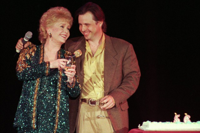 Debbie Reynolds et Todd Fisher, en 1997.... (Photo Lennox McLendon, archives Associated Press)