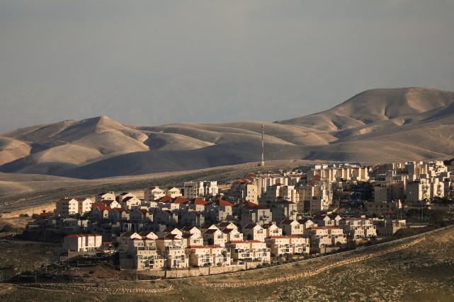Israël a procédé en janvier à cinq annonces... (Photo Ammar Awad, REUTERS)