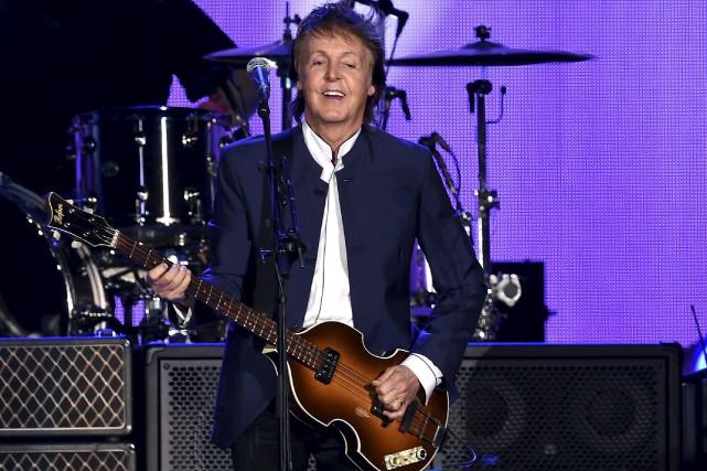 Paul McCartney entendait récupérer la maîtrise des titres... (AFP, Kevin Winter)