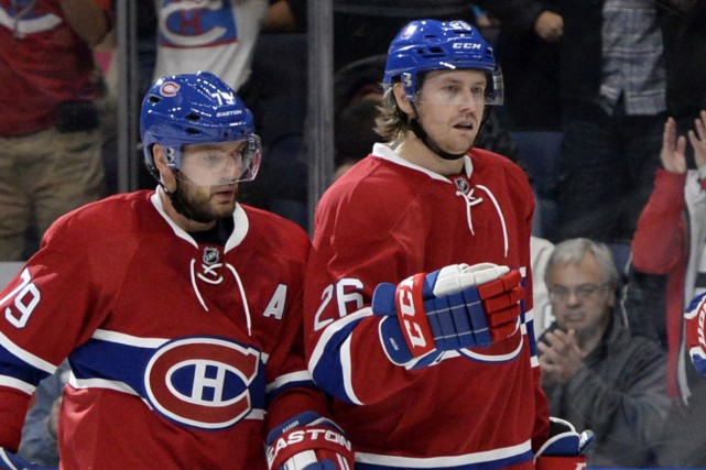 Andrei Markov et Jeff Petry lors d'un match... (PHOTO REUTERS)