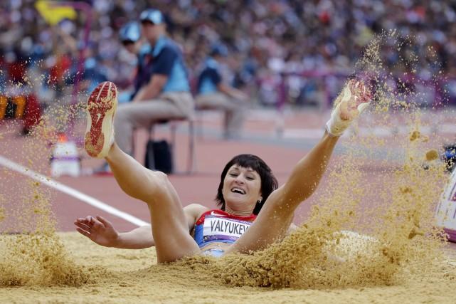 La triple sauteuse russeVictoria Valyukevich aux Jeux olympiques... (Photo David J. Phillip, archives AP)