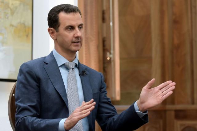Le président syrien Bachar al-Assad... (PHOTO ARCHIVES REUTERS/AGENCE SANA)
