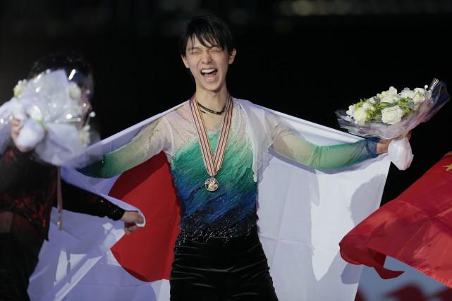 Hanyu Yuzuru est champion du monde: il ainscrit... (Photo Ivan Sekretarev, AP)