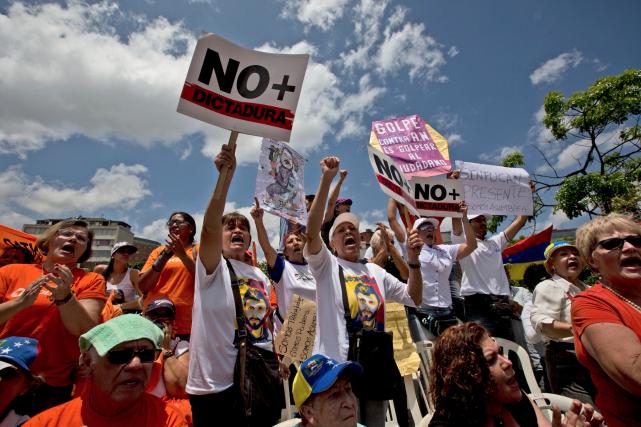 Les leaders de l'opposition avaient prévu manifester samedi... (AP, Fernando Llano)