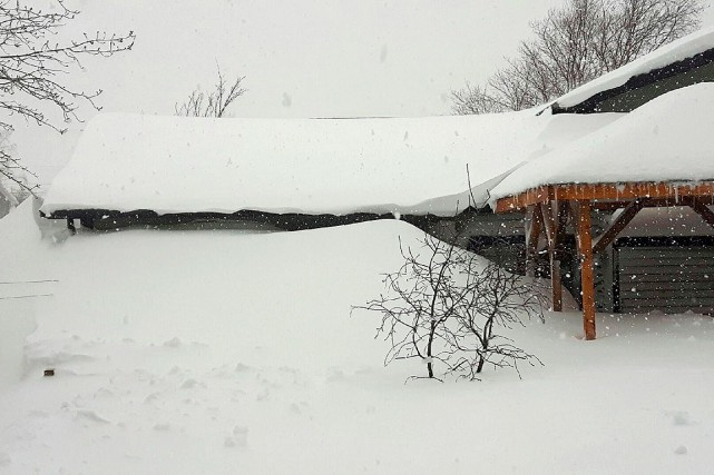 Snow is piled up in front of house... (THE CANADIAN PRESS)