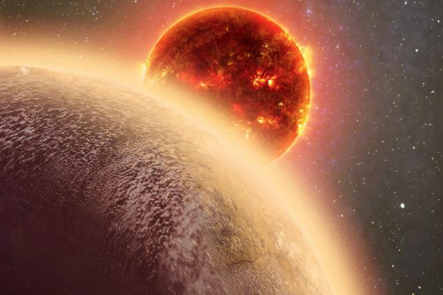 Cette exoplanète appelée GJ 1132b, située à 39... (AP, Dana Berry/SkyWorks/NASA)