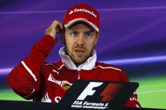 Le pilote de Ferrari Sebastian Vettel considère que... (AP, Andy Wong)