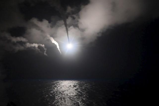Le navire de guerreUSS Portera tiré des missiles... (AFP, US NAVY)