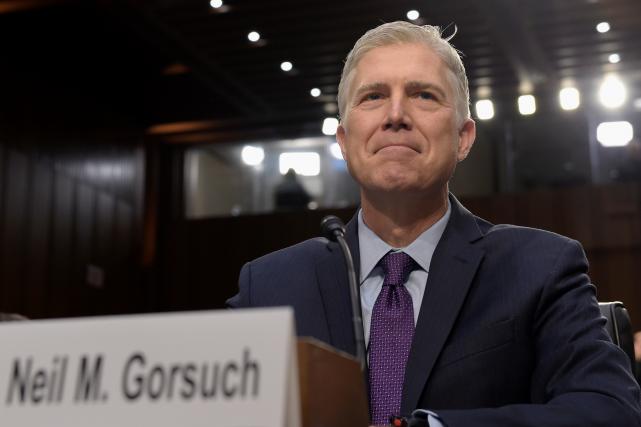 Neil Gorsuch, alors qu'il témoignait devant une commission... (AP, Susan Walsh)