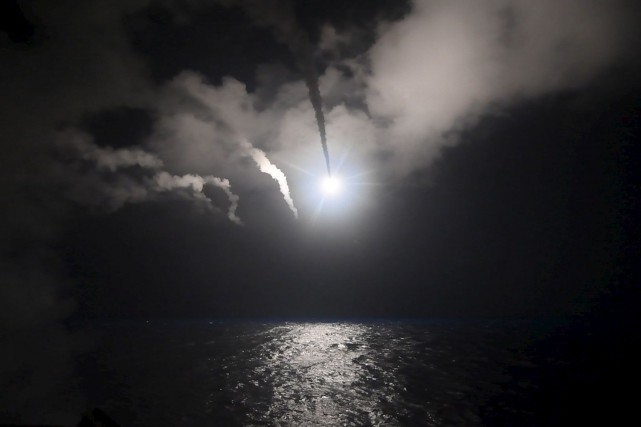 Près de 60 missiles Tomahawk ont été lancé... (AFP, US NAVY)
