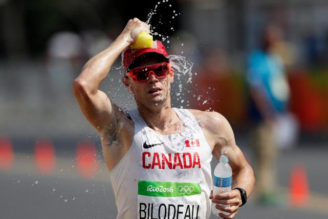Vaincu par la chaleur, Mathieu Bilodeau avait abandonné... (Archives AP)