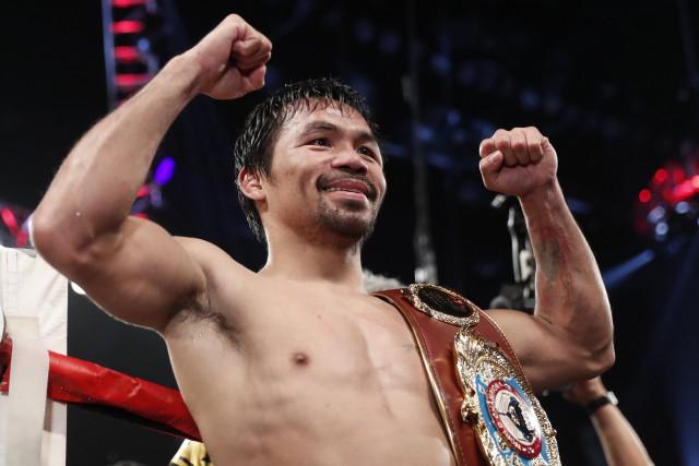 MannyPacquiaoa gagné 11 titres mondiaux dans huit catégories... (Photo Isaac Brekken, archives AP)