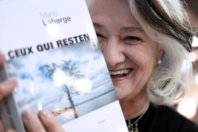 Le rendez-vous avec Marie Laberge était donné devant son kiosque, aux éditions...