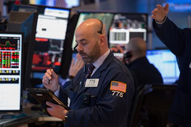 Wall Street a fini proche de l'équilibre lundi faute d'actualité économique... (PHOTO AFP)