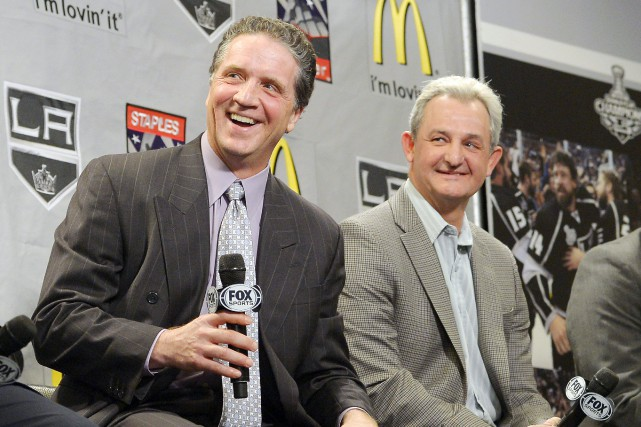 Dean Lombardi et Darryl Sutter... (Photo Mark J. Terrill, archives AP)