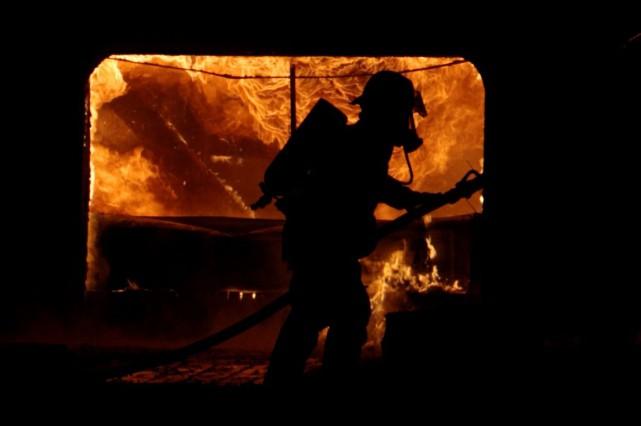 Quatre personnes ont été retrouvées mortes, mardi, après un incendie dans le... (Photo archives PC)