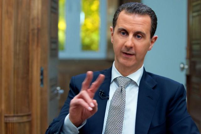La Russie et l'Iran, alliés du président syrien... (PHOTO ARCHIVES AFP)