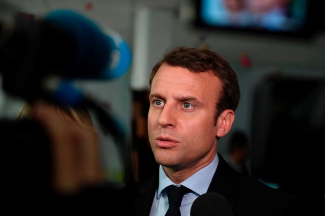Emmanuel Macron... (AFP, Eric FEFERBERG)