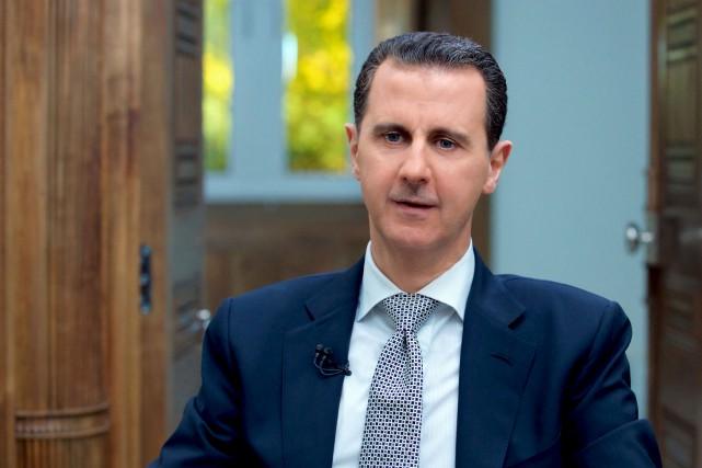 Le président syrien Bachar al-Assad a donné une... (AFP, Syrian Presidency Press Office)