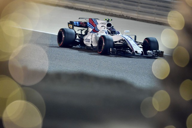 Lance Stroll au volant de sa Williams... (PHOTO ANDREJ ISAKOVIC, archives AFP)