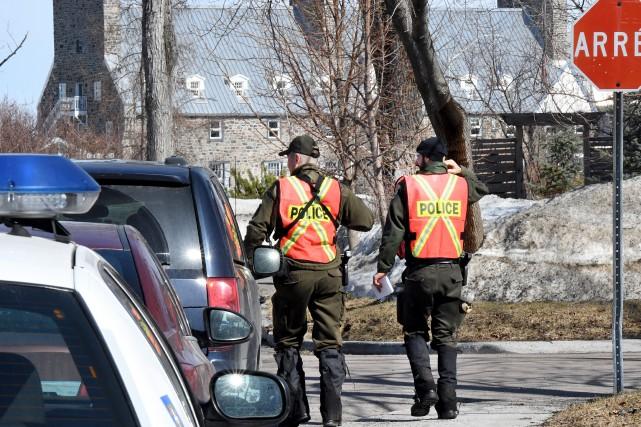 Environ 20 patrouilleurs de la Sécurité publique de... (Le Progrès, Rocket Lavoie)