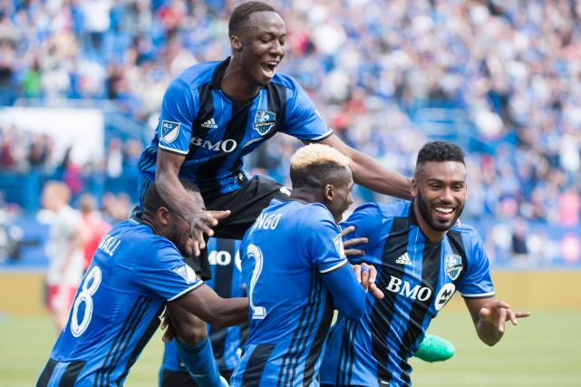 Le but d'Anthony Jackson-Hamel (à droite) marqué dans... (La Presse canadienne, Graham Hughes)