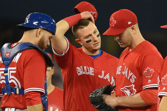 J.A. Happ (33), Russell Martin (55) et Troy... (Photo Dan Hamilton, USA TODAY Sports)