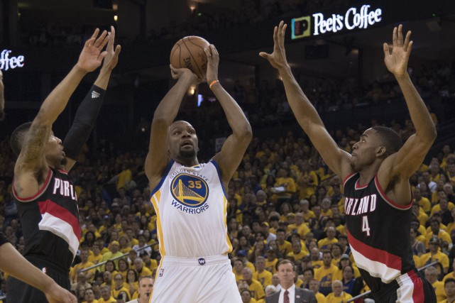 Kevin Durant fait face à Damian Lillard (0)... (Photo Kyle Terada, USA TODAY Sports)