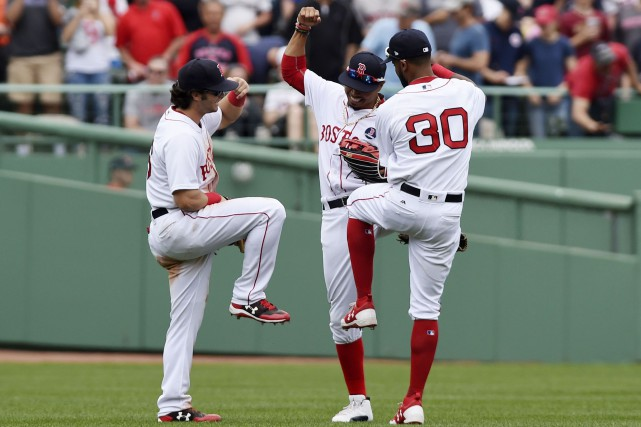 Andrew Benintendi (16), Mookie Betts (50) et Chris... (Photo Bob DeChiara, USA TODAY Sports)