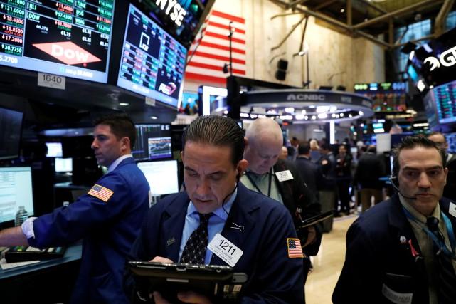 Wall Street a terminé en baisse mardi, entre regain des incertitudes politiques... (PHOTO ARCHIVES REUTERS)