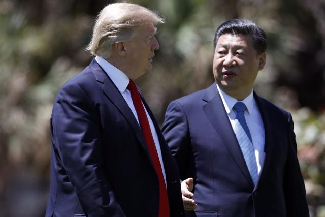 Évoquant sa récente rencontre avec le président chinois... (AP)