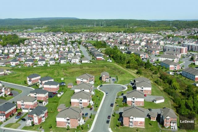 Entre les prévisions de la Société canadienne d'hypothèques et de logement... (Patrick Woodbury, Archives Le Droit)