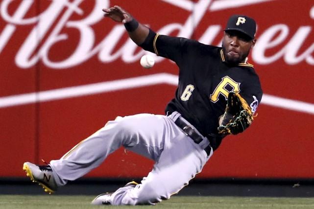 Le voltigeur des Pirates de Pittsburgh, Starling Marte,... (AP, Jeff Roberson)