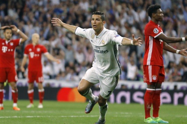 Les trois filets de Cristiano Ronaldo ont permis... (Francisco Seco, Associated Press)