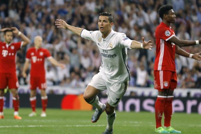 Les trois filets de Cristiano Ronaldo ont permis... (Francisco Seco, Associated Press)
