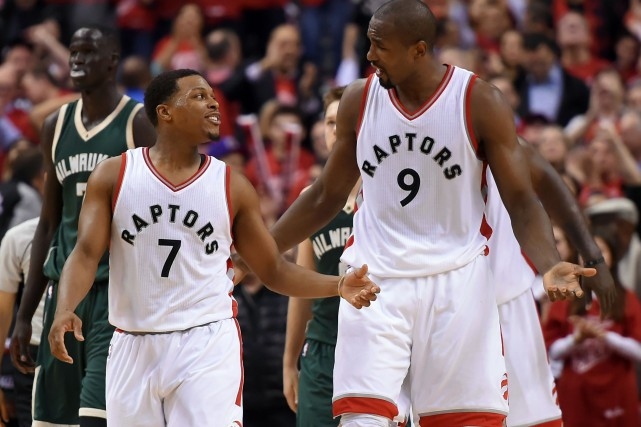 Kyle Lowry (7) et Serge Ibaka (9)... (Photo Dan Hamilton, USA Today Sports)