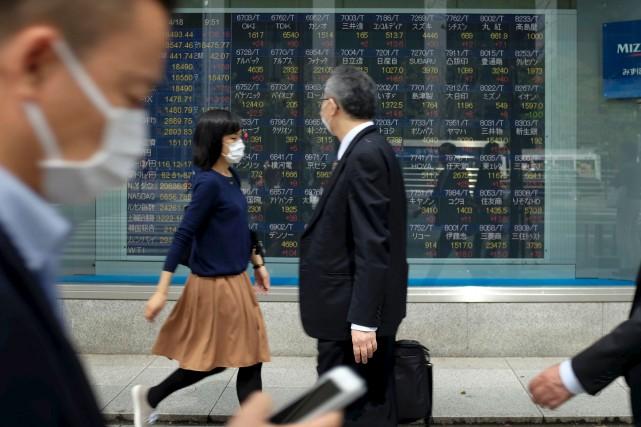 La durée excessive de labeur est un problème... (AFP, Kazuhiro Nogi)