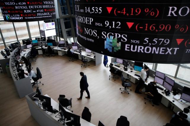 «L'ambiance est calme dans les salles de marché,... (AFP)