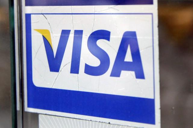 Visa a affiché jeudi un bénéfice net du deuxième trimestre de 430 millions $... (Photo Mark Lennihan, archives AP)