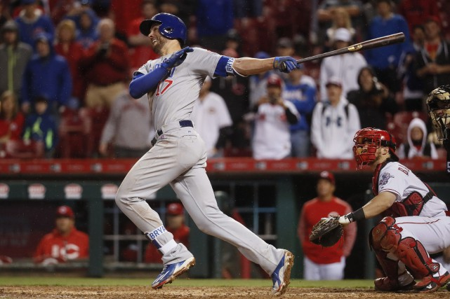 Le sacrifice gagnant de Kris Bryant.... (Photo John Minchillo, AP)