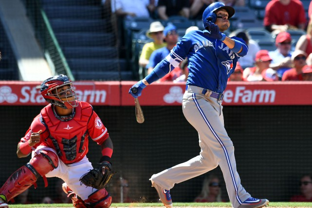 Ryan Goins a frappé un circuit en 9e... (Photo Richard Mackson, USA TODAY Sports)