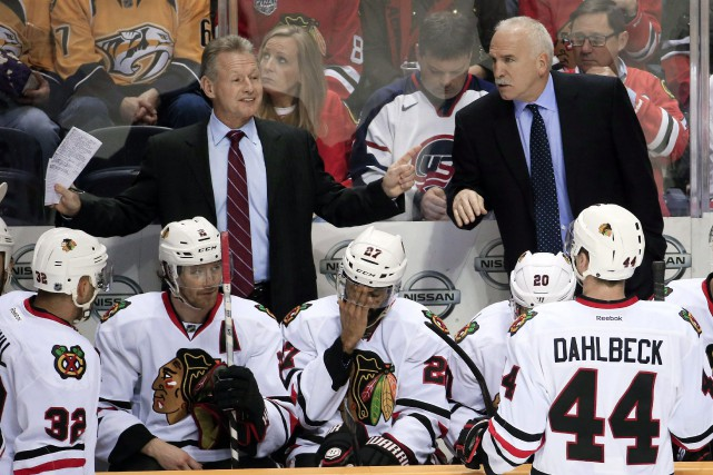 Mike Kitchen (à gauche)s'était joint au personnel de... (Photo Mark Humphrey, archives AP)