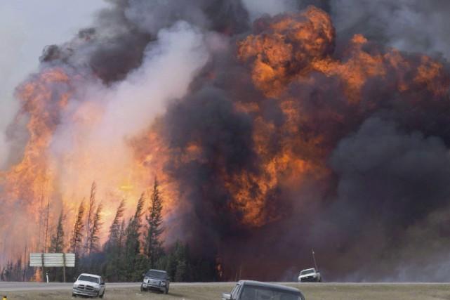 L'incendie de mai dernier avait détruit environ 10... (La Presse canadienne, Jonathan Hayward)