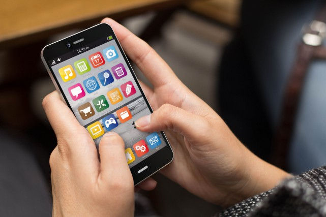«Avec les téléphones intelligents et les tablettes électroniques,... (123rf)
